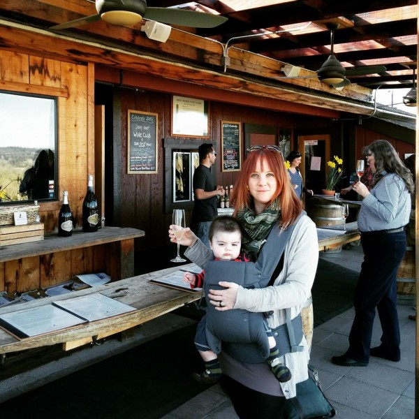 baby in a carrier at a winery in california